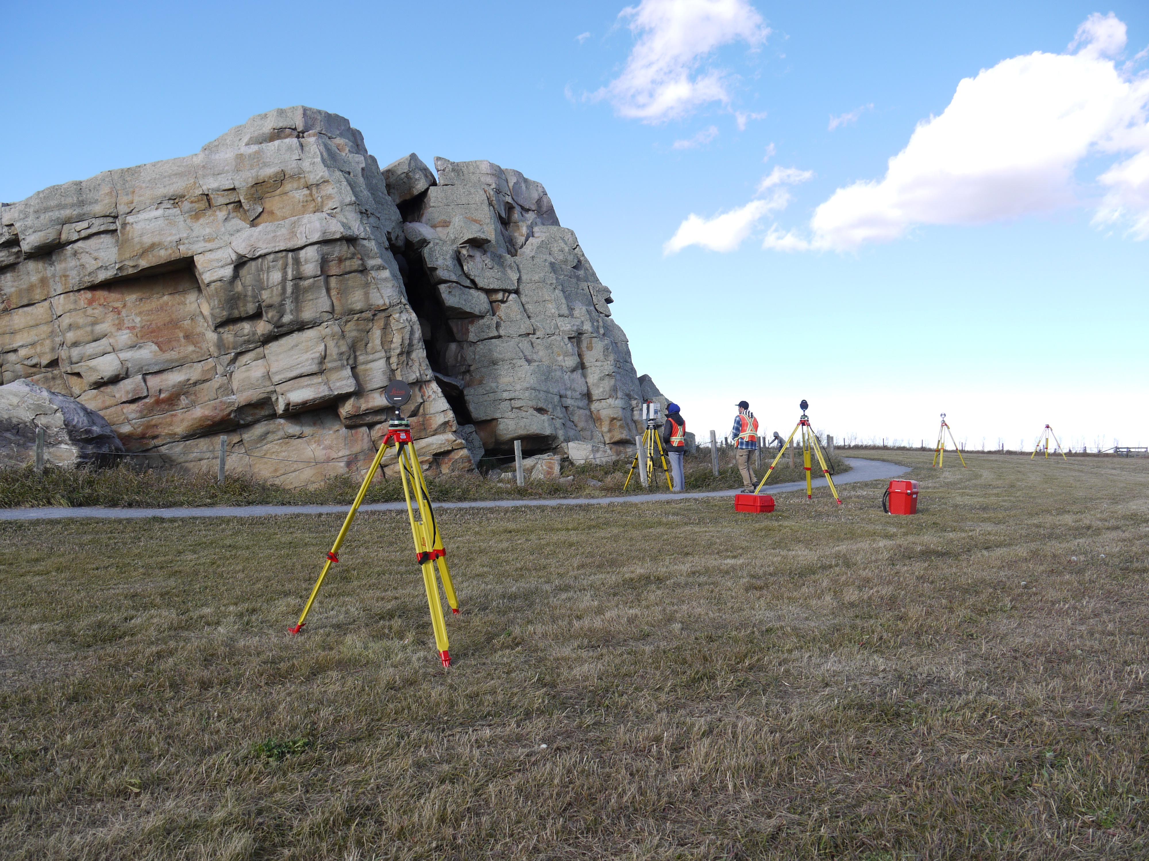Geomatics Engineering students laser scanning Okotoks Erratic, October 2016.